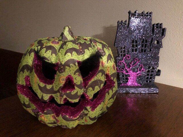 Bolder, brighter Halloween decorations, like these spooky finds from Mary Ellen, might need to be displayed on their own!