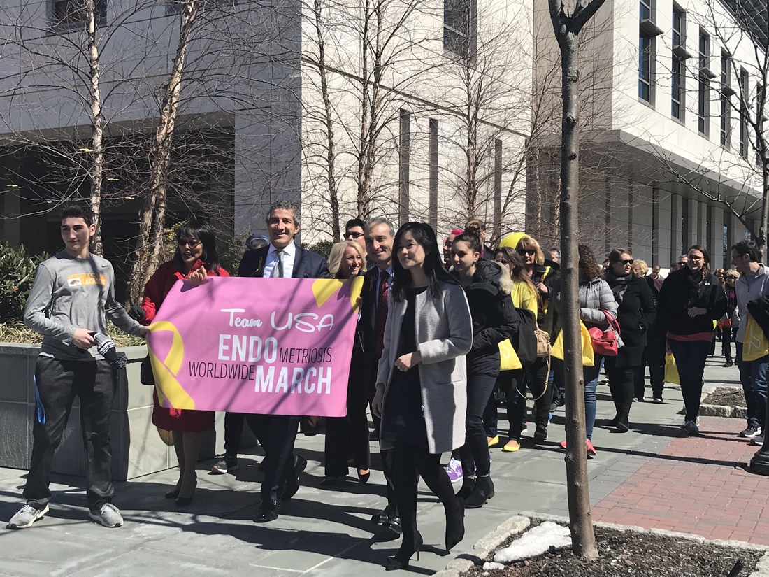 new york 2018 dr farr nezhat front of line with banner.jpg