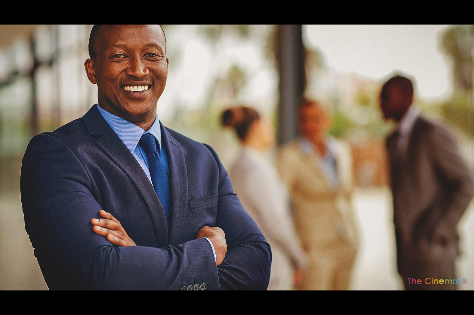 Young black successful smiling executive Cinematic corporate photography by Kamal Lahmadi/THE CINEMATIK