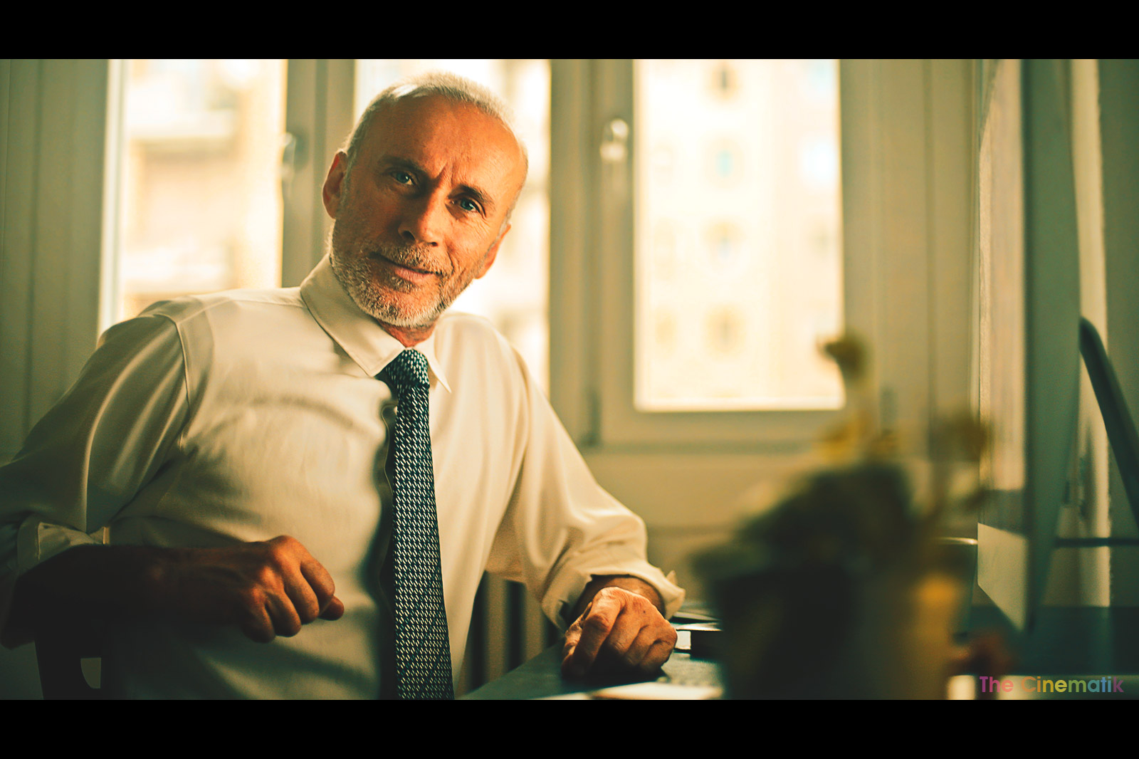Old executive at his desk Cinematic corporate photography by Kamal Lahmadi/THE CINEMATIK