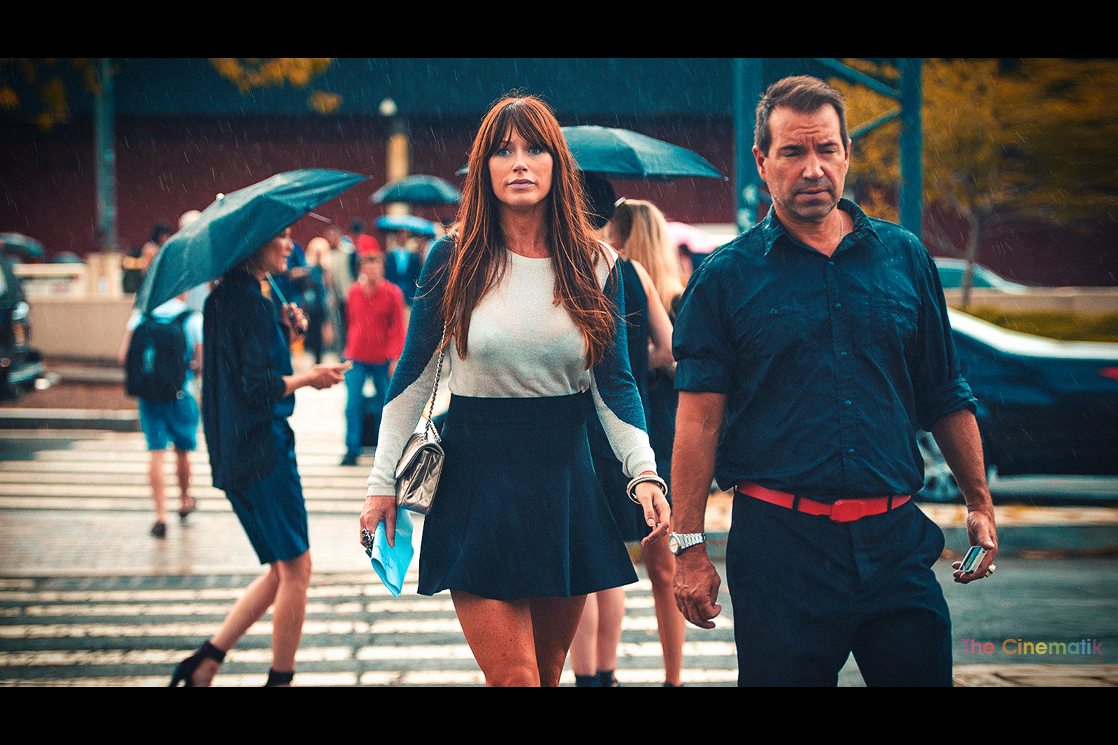 Gorgeous mini-skirt guest under the rain at New York Fashion Week cinematic photograph by Kamal Lahmadi/THE CINEMATIK