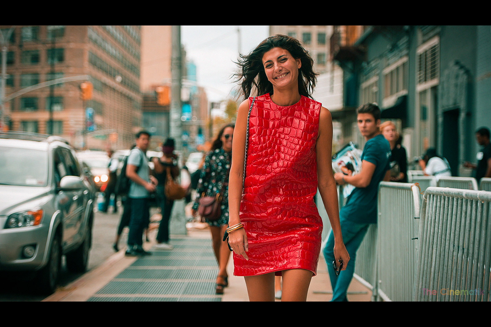 Giovanna Battaglia in leather croco red dress laughing with me at New York Fashion Week cinematic photograph by Kamal Lahmadi/THE CINEMATIK
