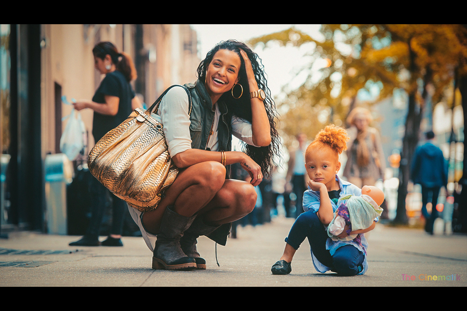 Model Eishia Brigtwell lauging ate her daughter Legend Pearl as she poses in New York cinematic photograph by Kamal Lahmadi/THE CINEMATIK
