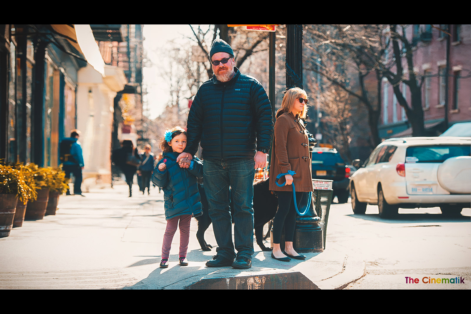 Big daddy holding his little daughter's hand in New York cinematic photograph by Kamal Lahmadi/THE CINEMATIK
