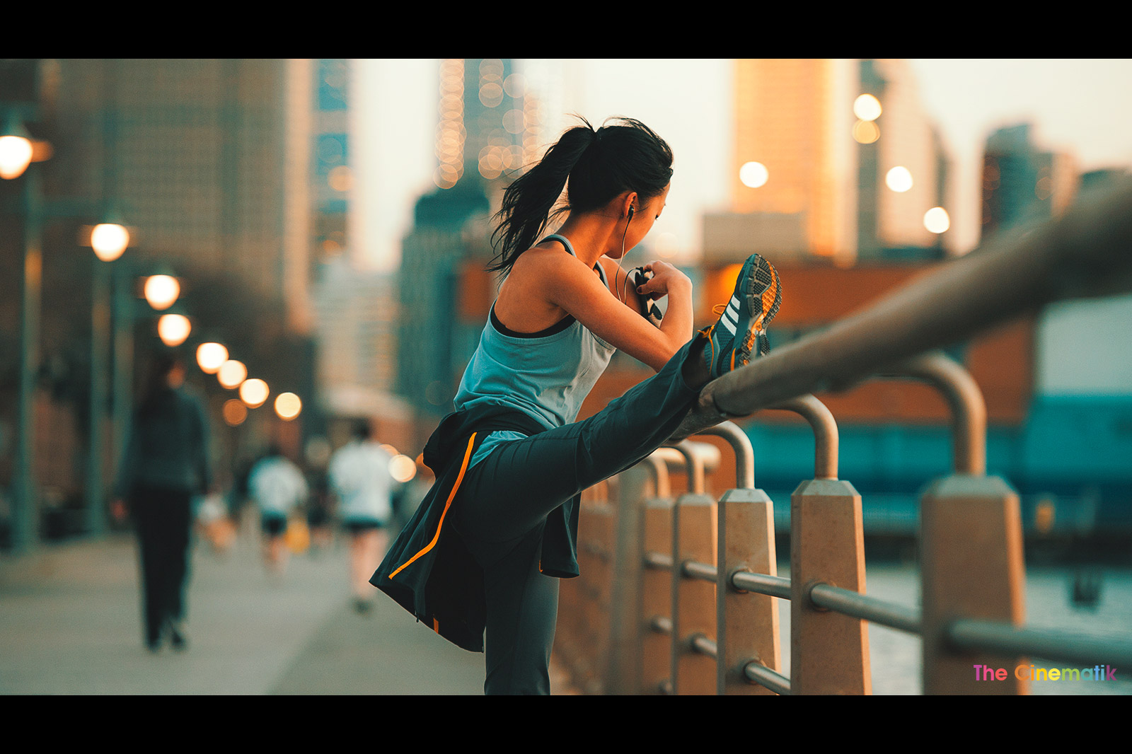 asian-young-woman-wearing-adidas-sneakers-streching-while-listening-to-music-in-New-York-City.jpg