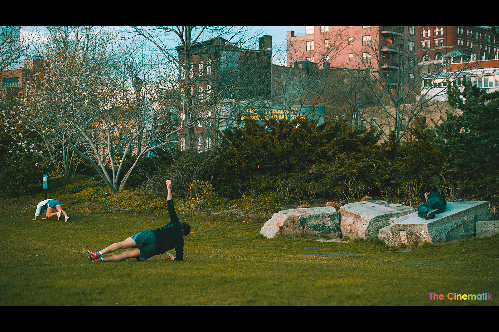 man-and-woman-working-out-close-to-homeless-sliping-on-a-rock-in-New-York-City.jpg