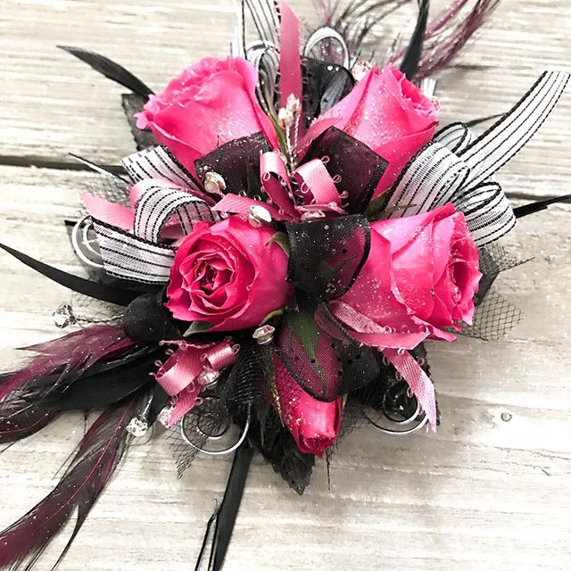 Do you know what makes my heart happy? This prom corsage is going all the way to Lincoln! And will you get a look at those feathers?! 💜💜 #thecountrystore