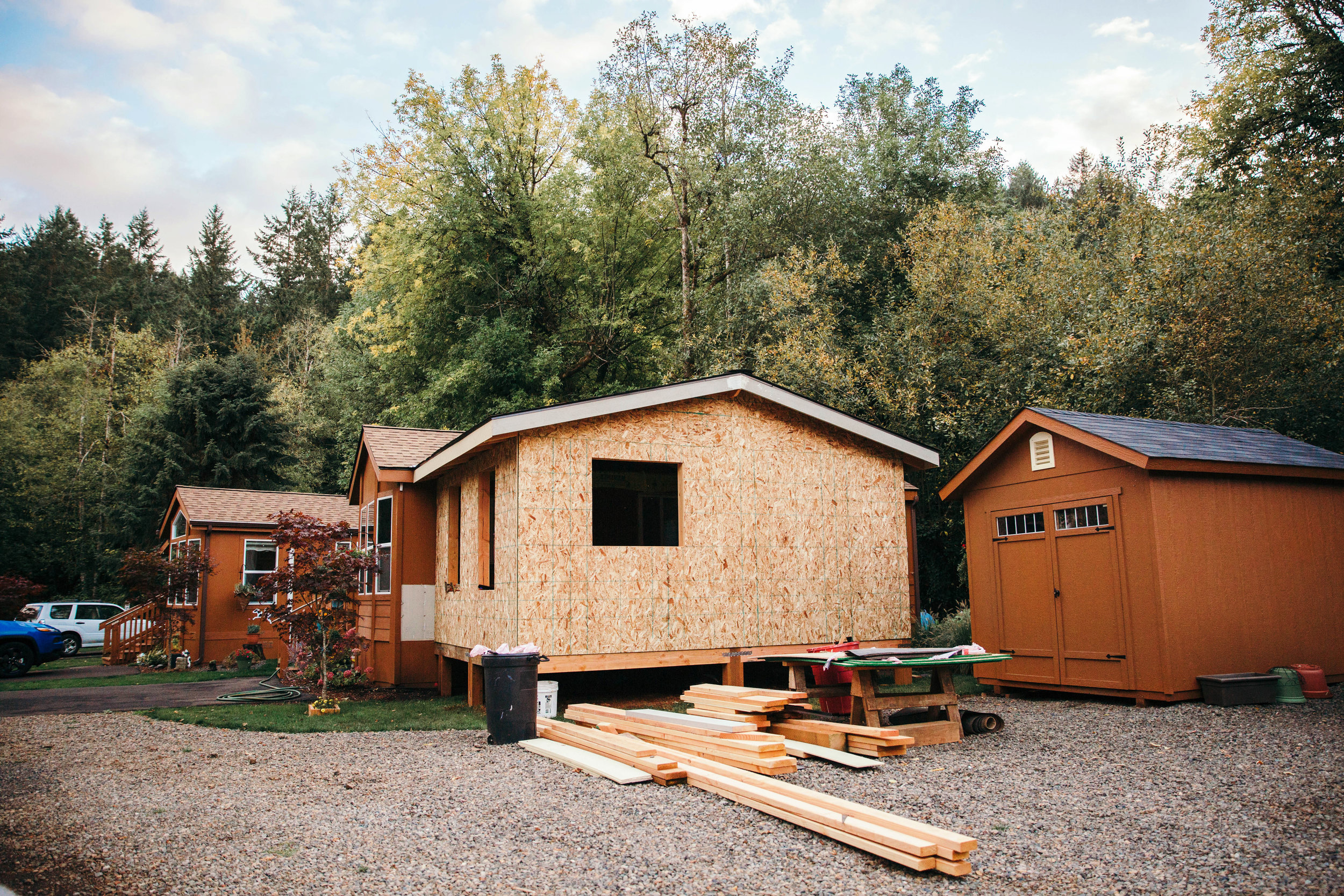 House Under-Construction with Wooden Planks Beside It