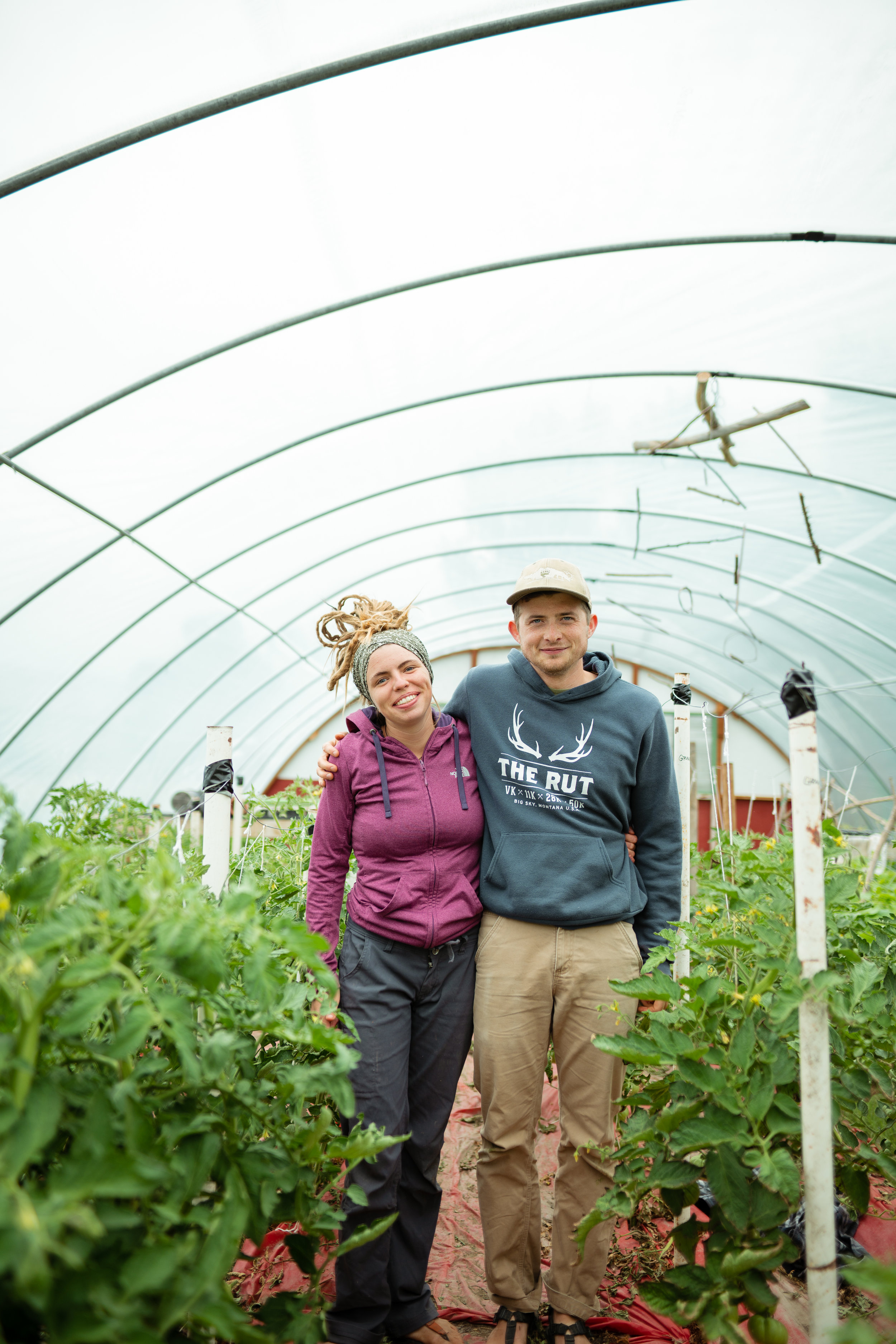 Kacy Senger and Zach Altman pose in their greenhouse at Sprig & Root Farm in Clarkston, Montana.