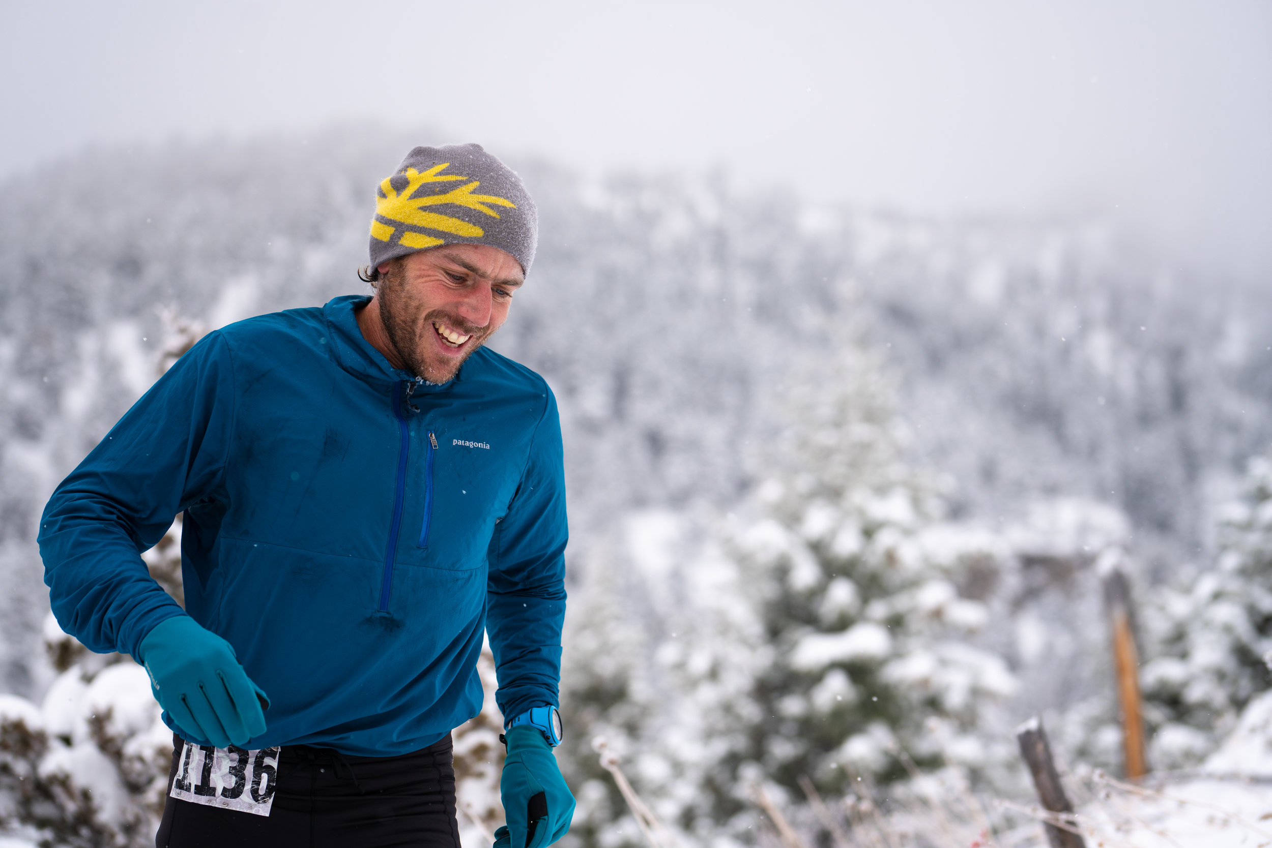Runners battle winter snow that coats the Bridgers during Bozeman Running Co. racing of the Foothills 14k up Sypes Canyon. Runner Alan Adams.