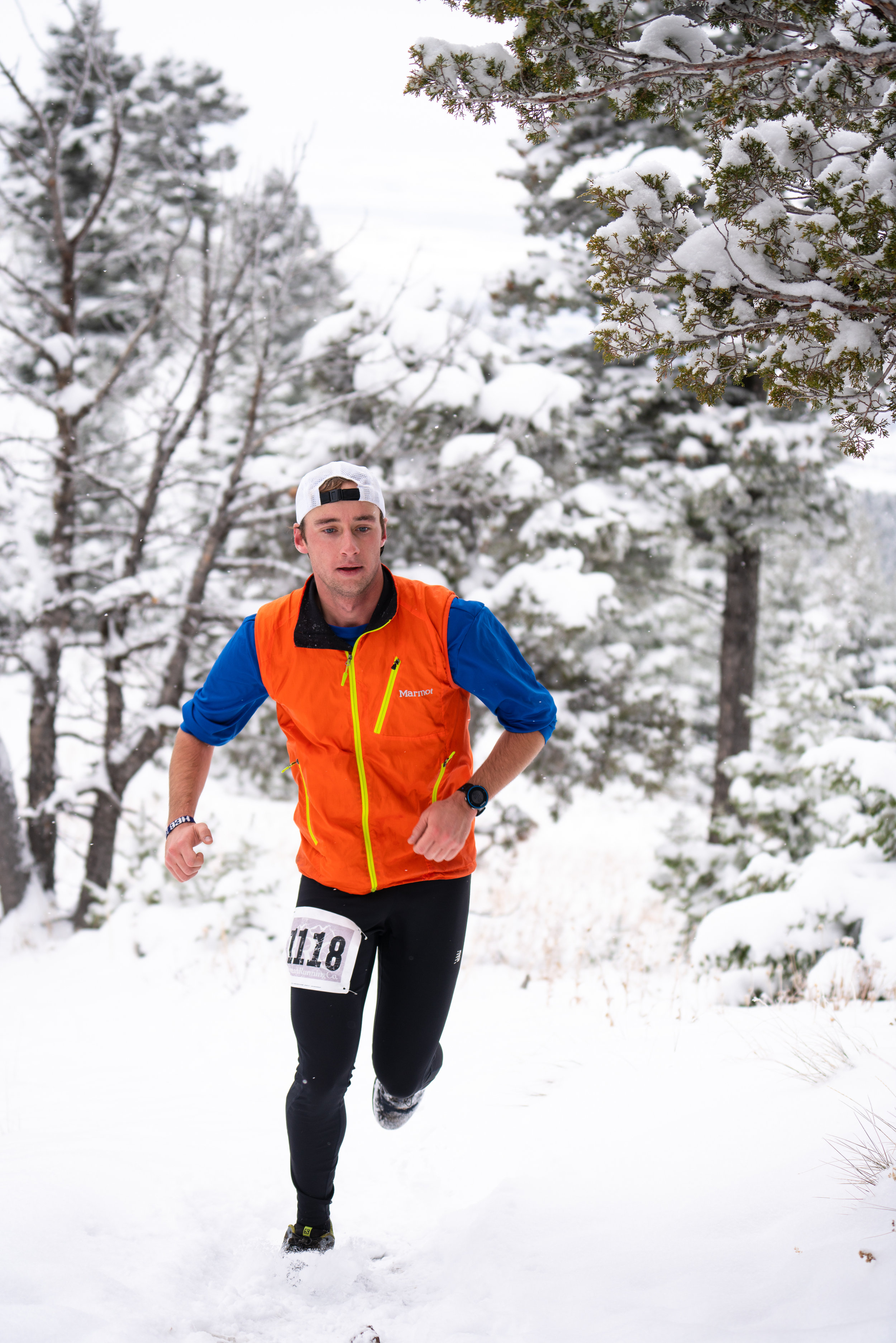 Runners battle winter snow that coats the Bridgers during Bozeman Running Co. racing of the Foothills 14k up Sypes Canyon.