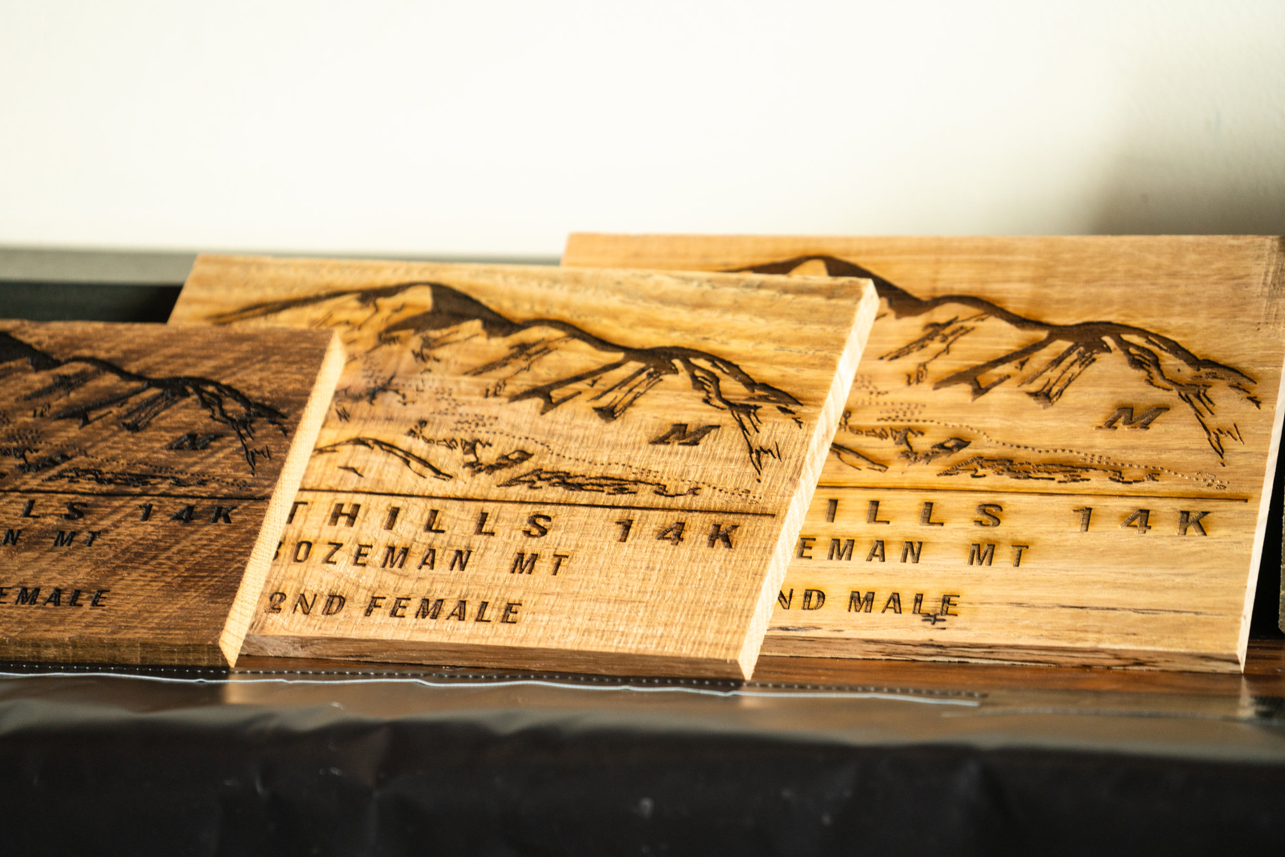 Awards from Bozeman Running Co. racing of the Foothills 14k up Sypes Canyon.