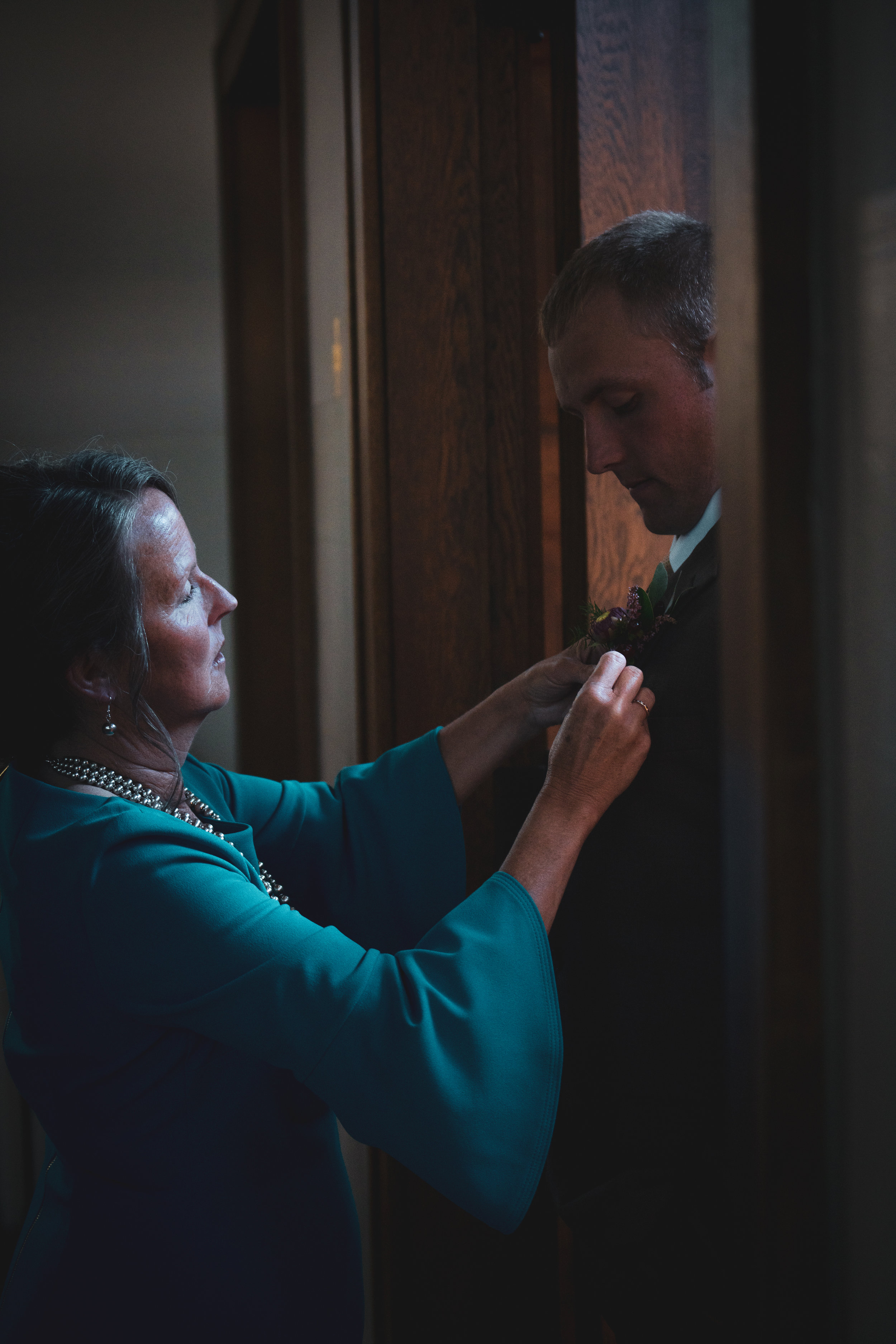 The Groom and his mother photographed before the wedding in a Montana church