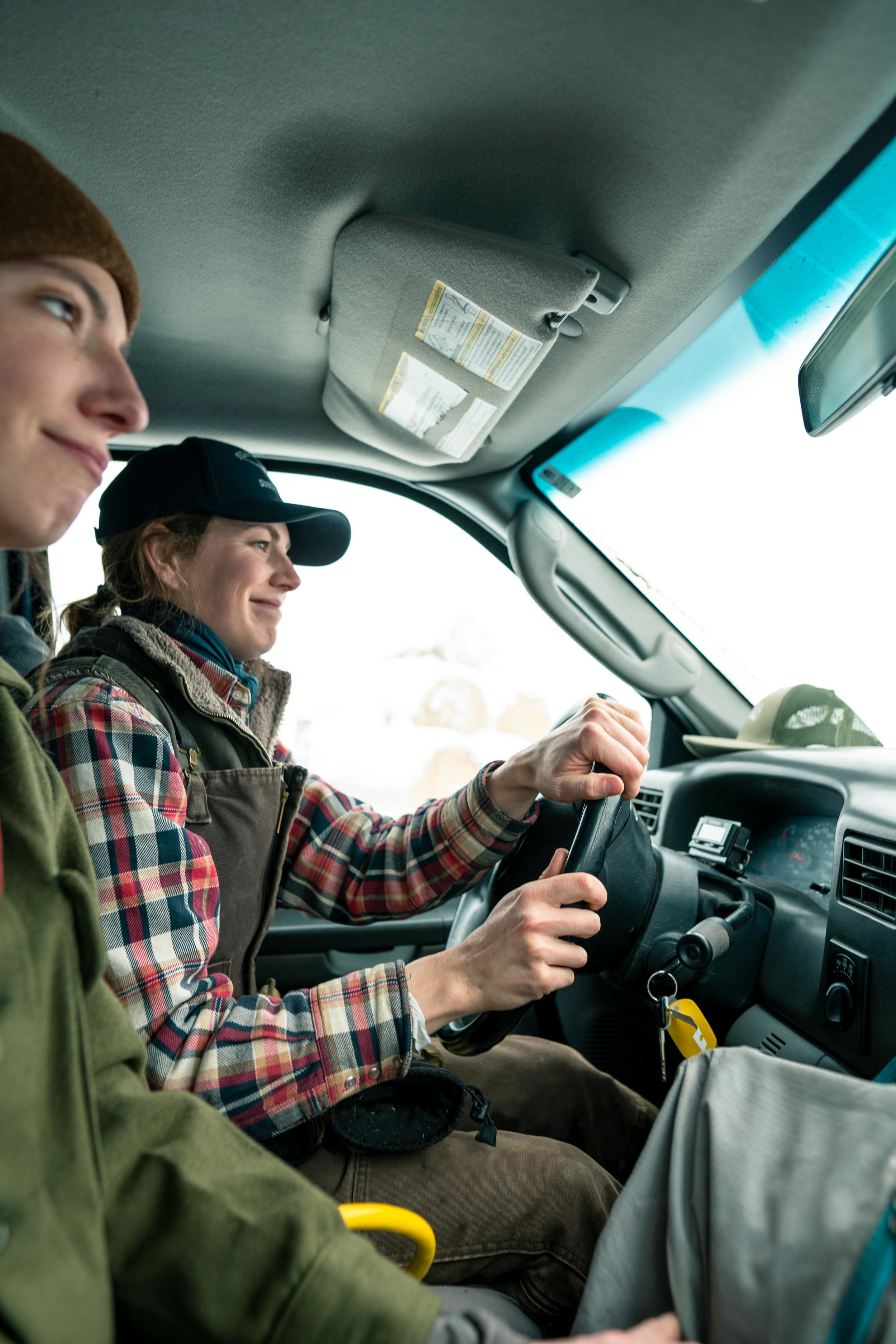 Jenna Flatgard driving the truck during feeding.