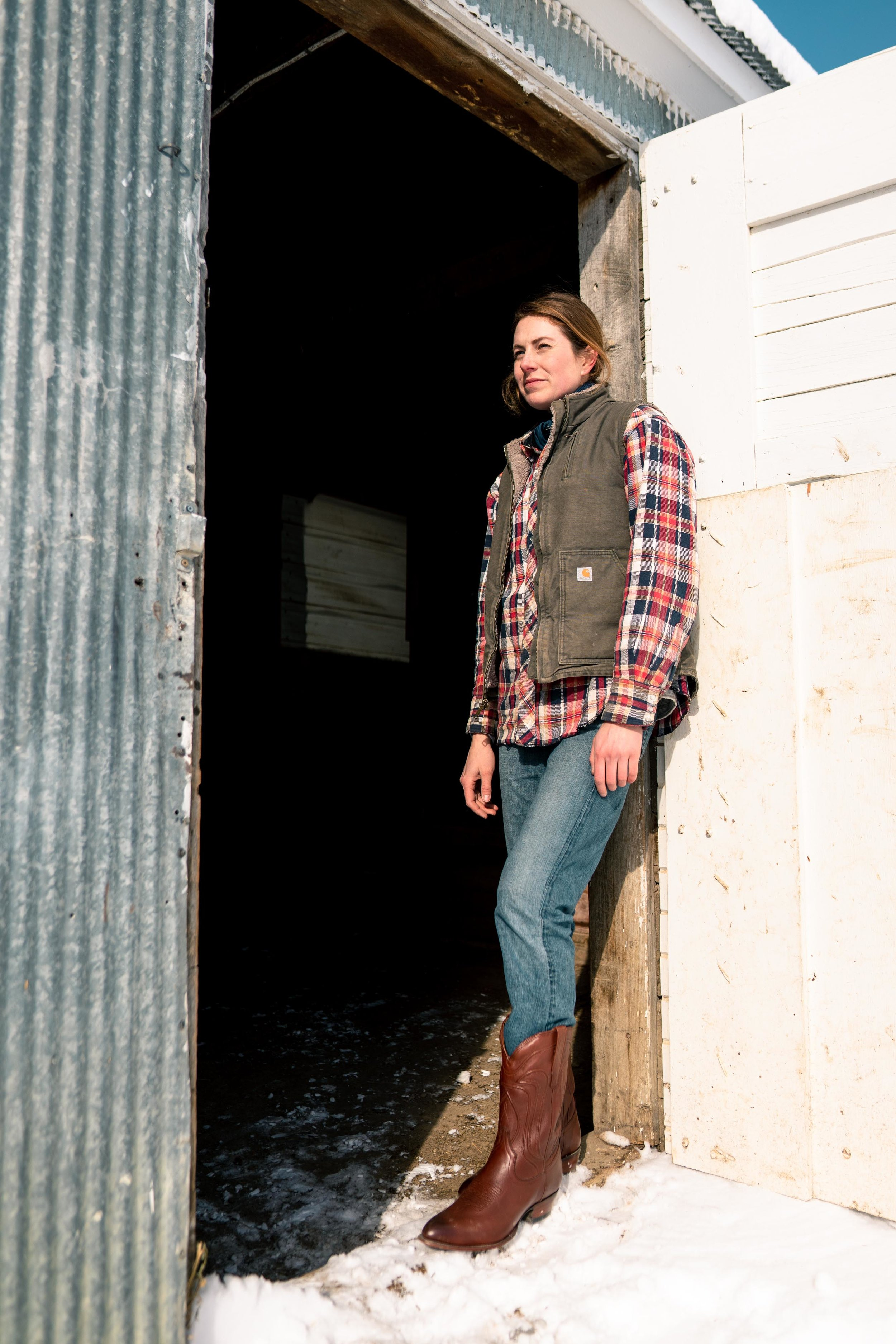 Jenna Flatgard wearing Tecovas while pausing in the sun in eastern Montana.