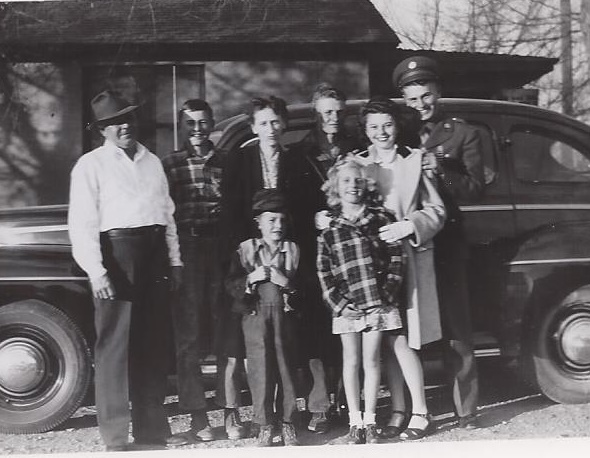 """Conrad Firestien Family, 1940s Pictured, from left to right, are Conrad """"Coonie"""", David, Mabel, Wilbert """"Chuck"""", Wynona and Wallace """"Wally"""". In front are Gerald and Shirley."""