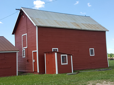 View of the barn and milkhouse from the northeast corner.