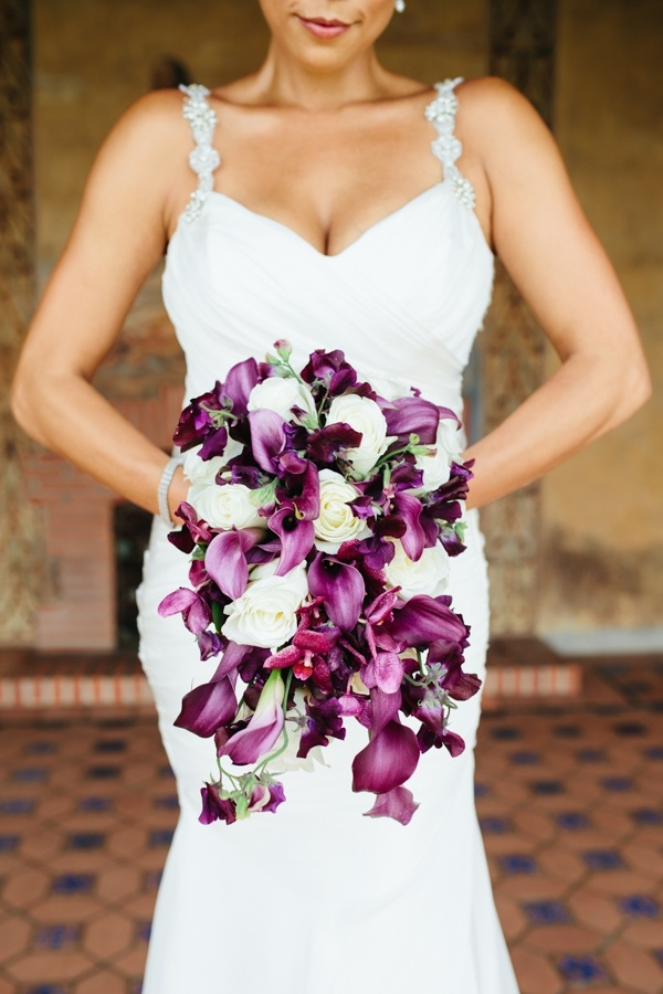 A stunning purple orchid and white rose wedding bouquet