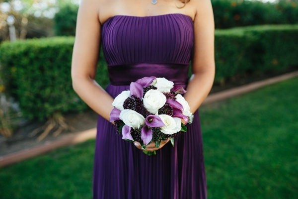 Bridesmaid in purple with a gorgeous bouquet