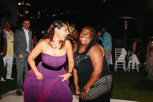 Guests having LOTS of fun at this modern and glam outdoor wedding reception!