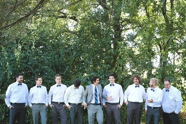 The groom and his groomsmen in dapper bowties
