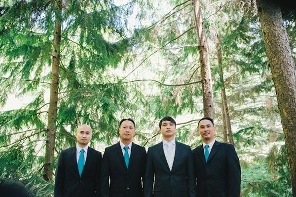 Groomsmen in teal and black suits