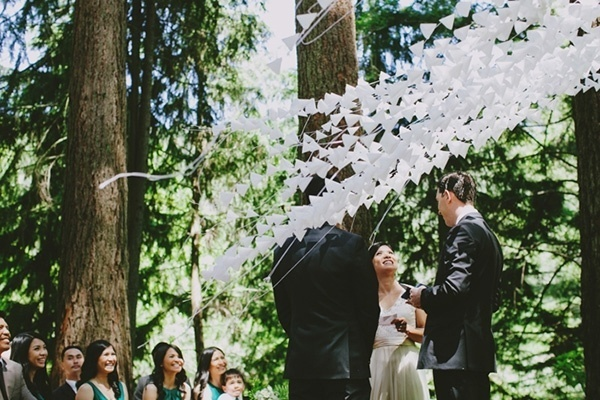 Wedding ceremony photo with a lovely white backdrop