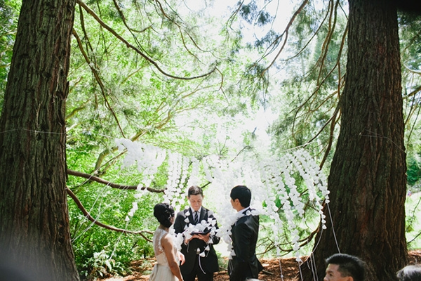 Wedding ceremony in the forest with a gorgeous backdrop