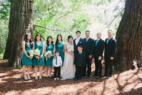 Bridesmaids and groomsmen in a romantic forest wedding