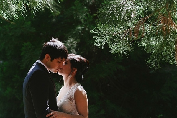 Romantic photo of the bride and groom in a forest wedding