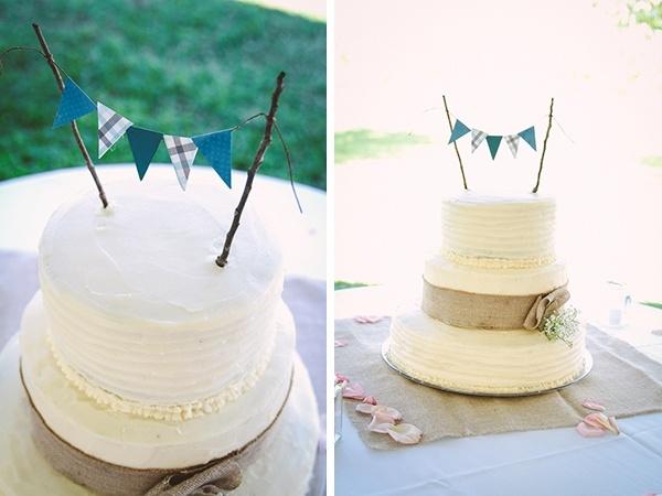 Wedding cake with pennants. So pretty!