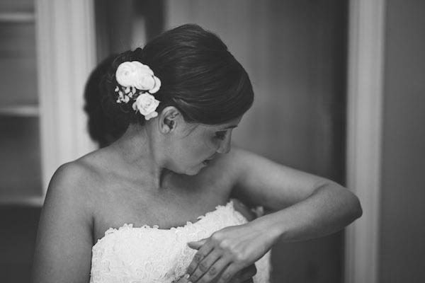 Bride getting dresses.