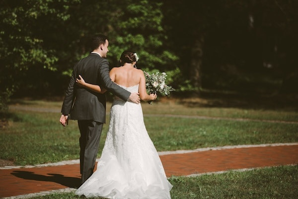 Gorgeous husband and wife walking away from the altar!