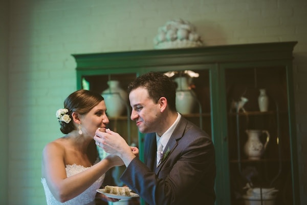 Sweet cake cutting moment between a bride and groom!