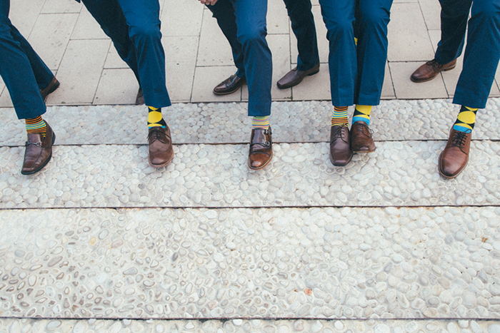 Groomsmen in navy suits and colorful socks!