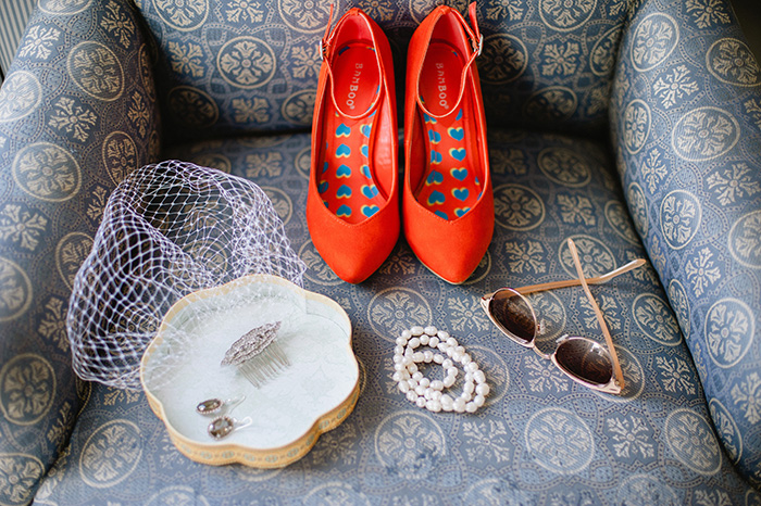 Red wedding shoes and vintage jewelry and details