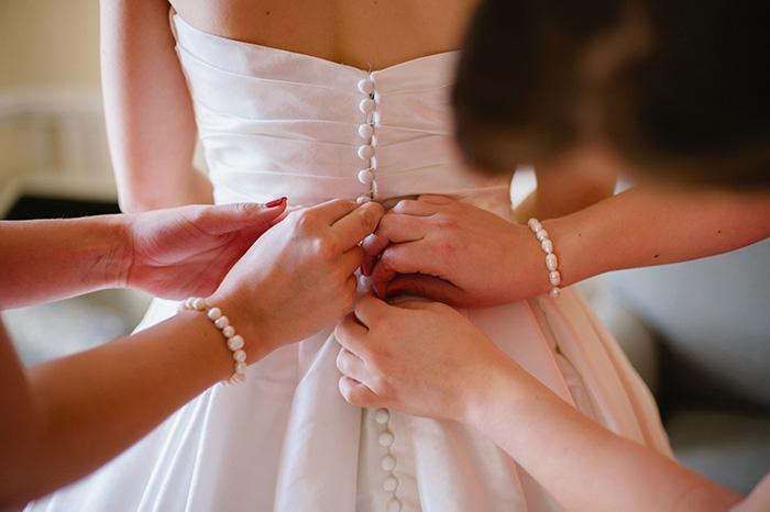 Wedding dress getting ready photo