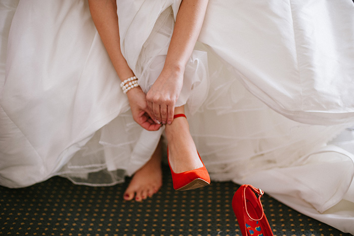Red wedding shoes bride