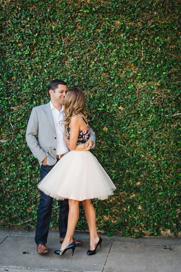 Such an adorable engagement photo moment. Love her pink tulle skirt!