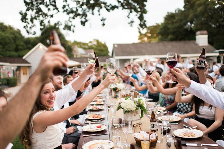 Guests at a backyard wedding ceremony