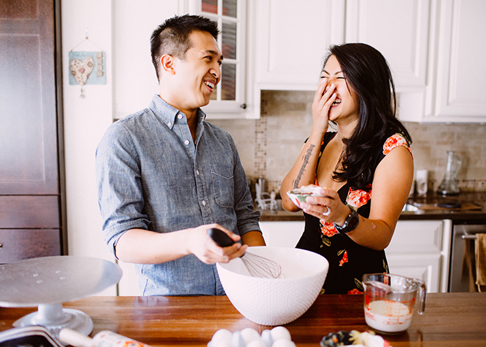 Fun cooking at home engagement photo