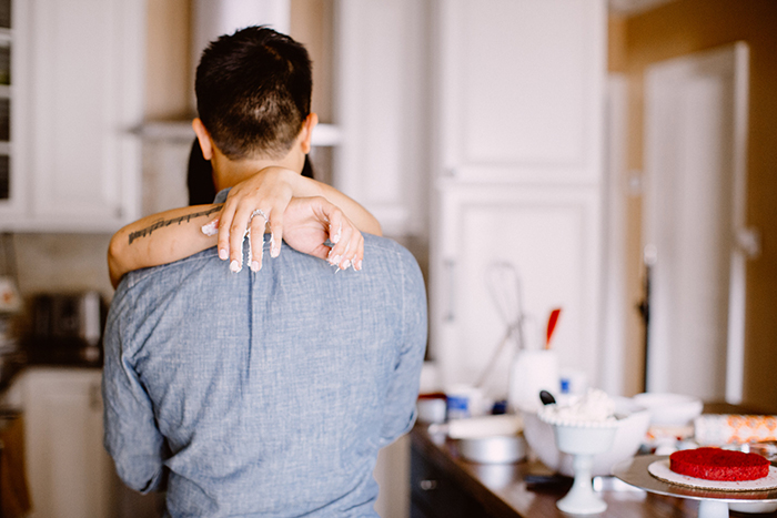 Engagement photos at home baking a cake. Great idea!