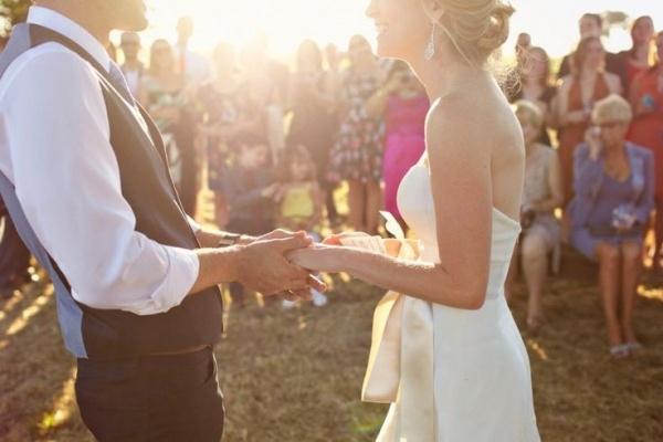 Stunning sunset wedding ceremony. Wedding photography by Marissa Maharaj.