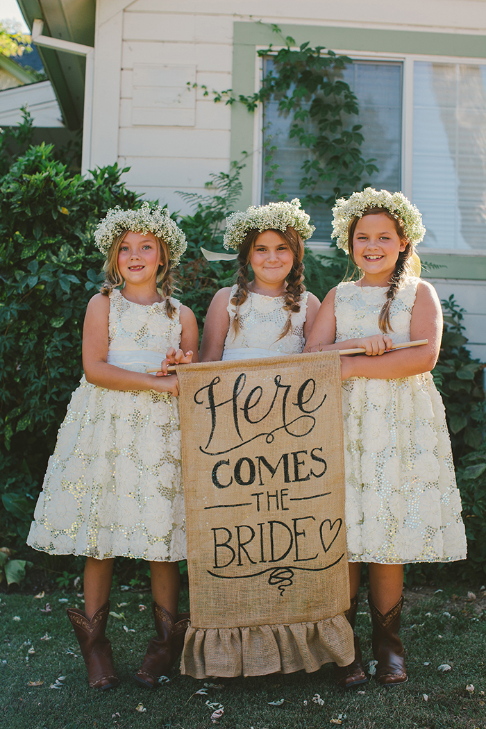 Flower girls and a rustic banner