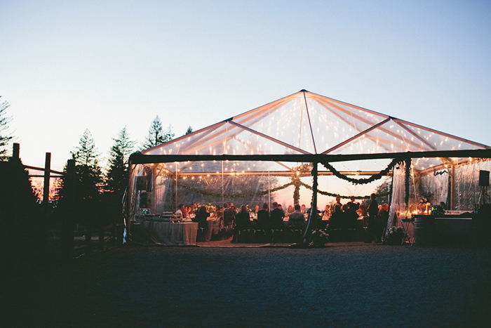 Rustic tented wedding ceremony