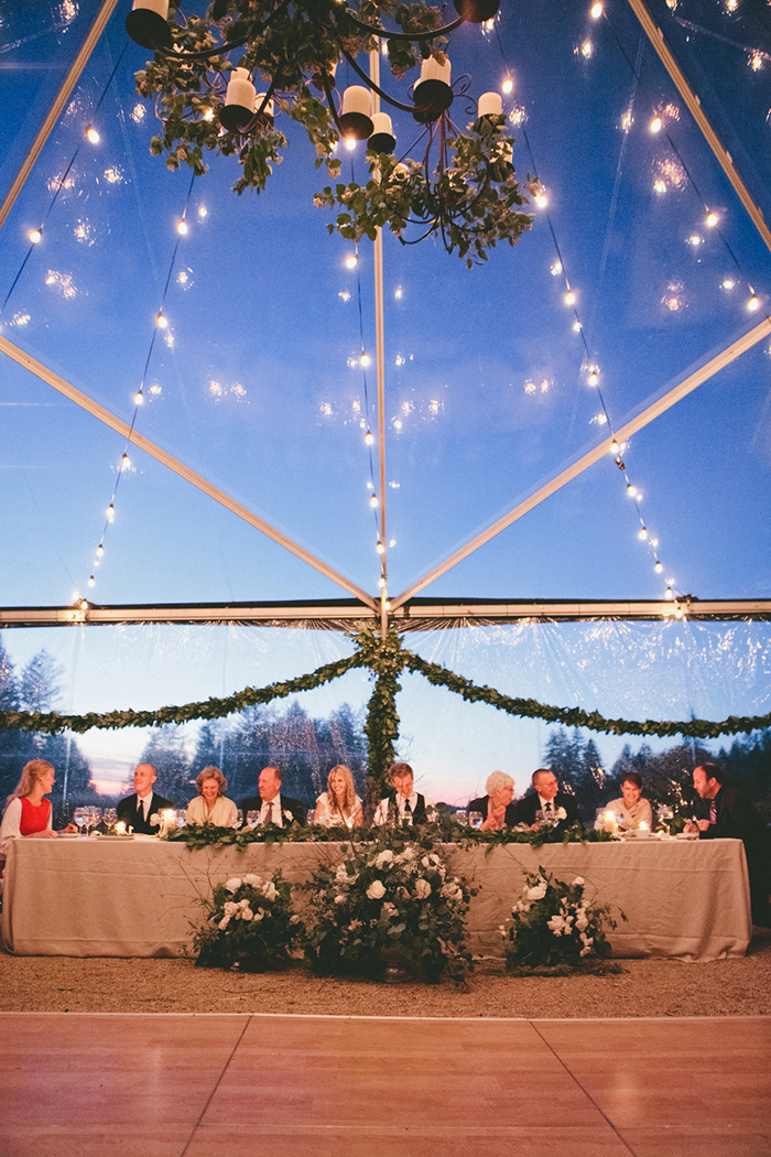 Stunning green and white wedding reception decor with bistro lights