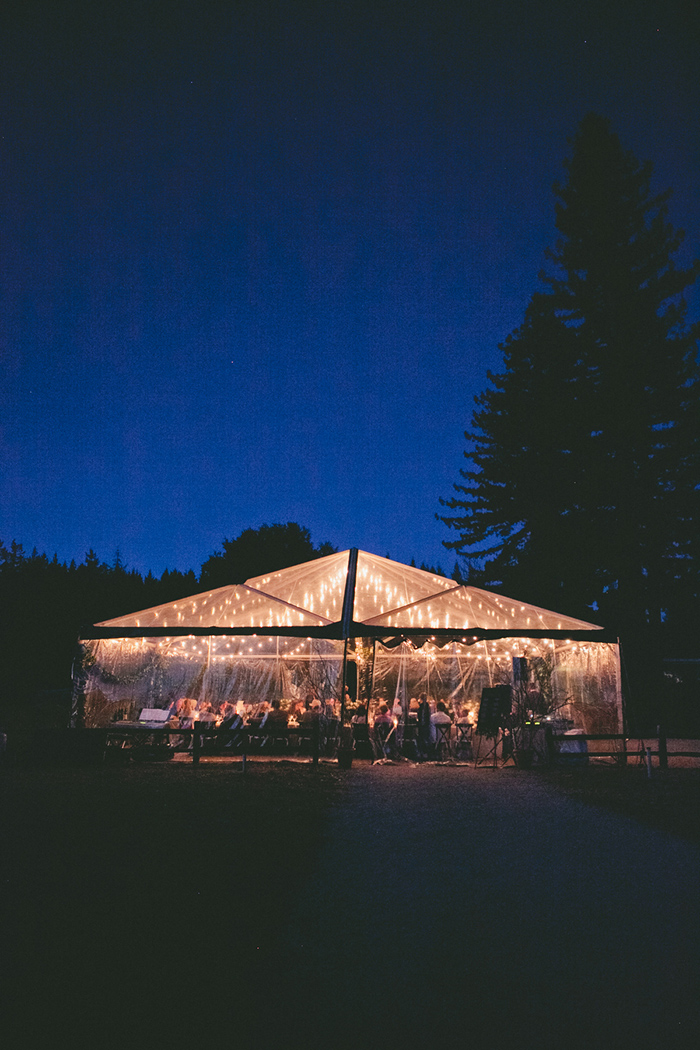 Tented wedding ceremony at night
