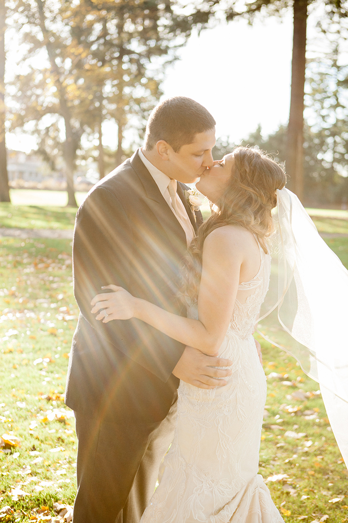 Gorgeous sunlit wedding photo of the bride and groom!