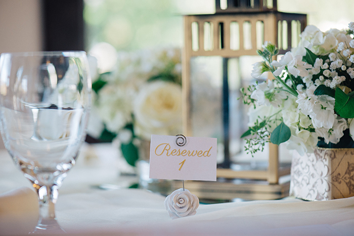 Sweet idea for a simple white and gold wedding centerpiece