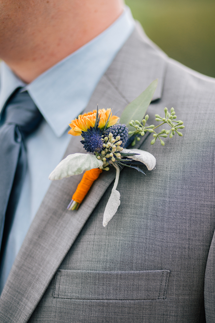Orange and blue boutonniere. Perfect for fall!